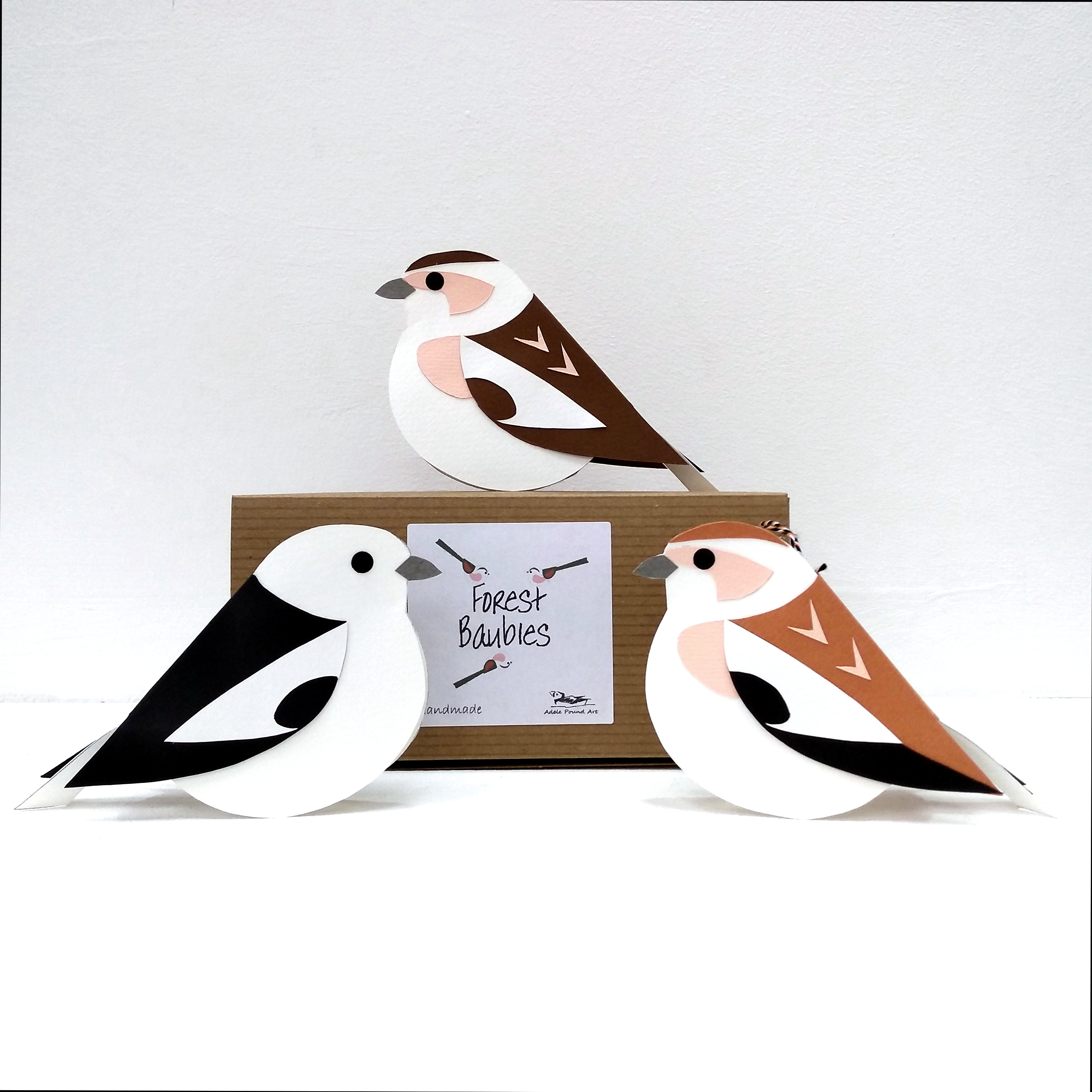 three handmade paper snow buntings in different plumages with gift box